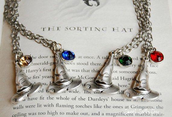 Harry Potter Sorting Hat Necklaces. I want the Ravenclaw one
