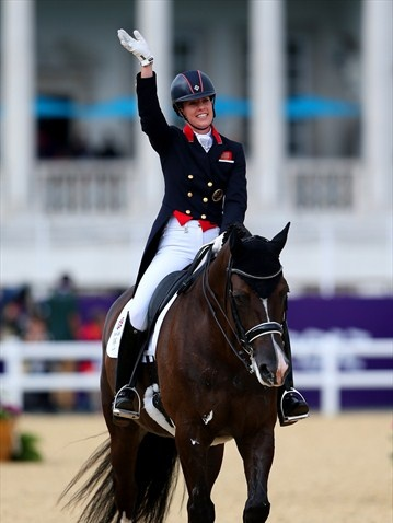 Charlotte Dujardin of Great Britain riding Valegro celebrates after competing in the Team Dressage Grand Prix Special on Day 11 of the London 2012 Olympic Games at Greenwich Park.  Team GB ended in gold medal position.