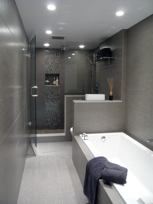 The full tiled walls makes this bathroom a modern oasis!