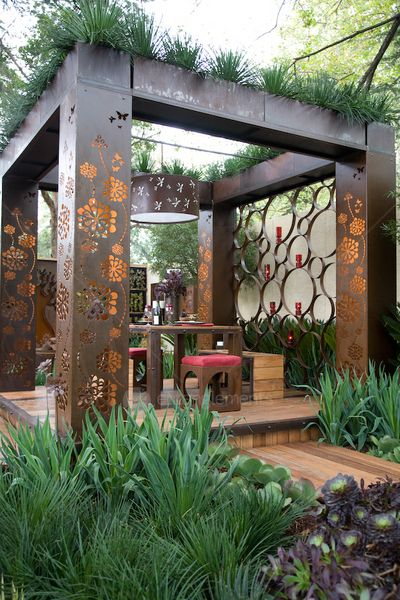 This unique pergola would make a beautiful focal point for any yard.