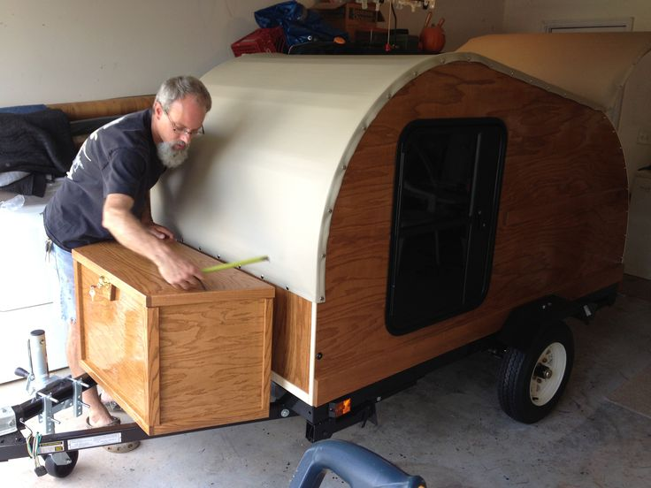 Brian is working on the finishing touches for this camper, a 4x8 with stabilizer jacks, air conditioning and a tongue box.
