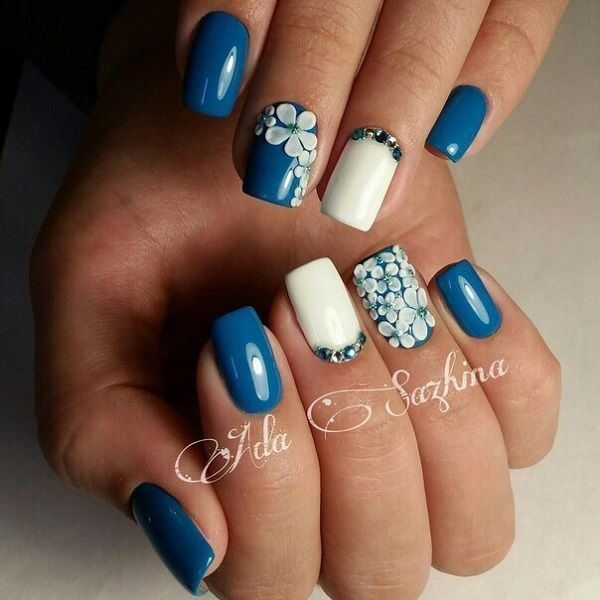 Coat your nails in beautiful blue color that represent the sea on the beach. You can then add white details on top that can represent as flowers then add beads on top of it. It looks refreshing and at the same time adds a more youthful glow to your skin.