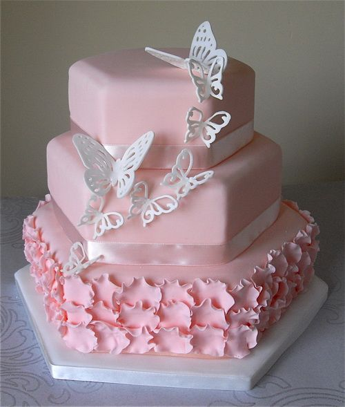cute pink cake for wedding with butterfly decorations