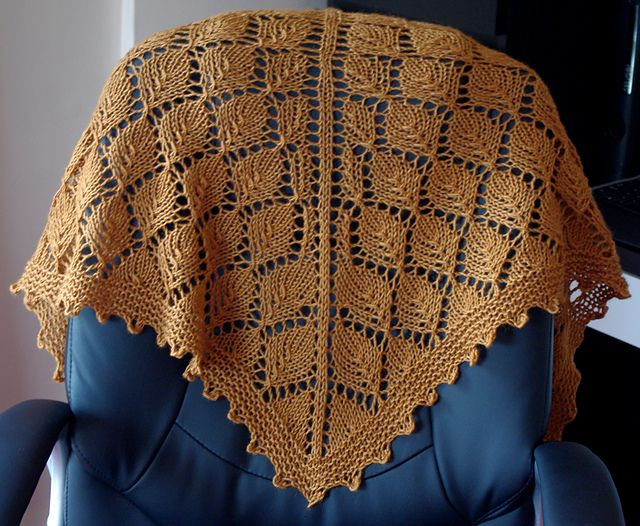 Ravelry: Superwash DK project gallery Beautiful leaf shawl. The gold works great with this as it gives it a really autumnal falling leaves feel. Love it.