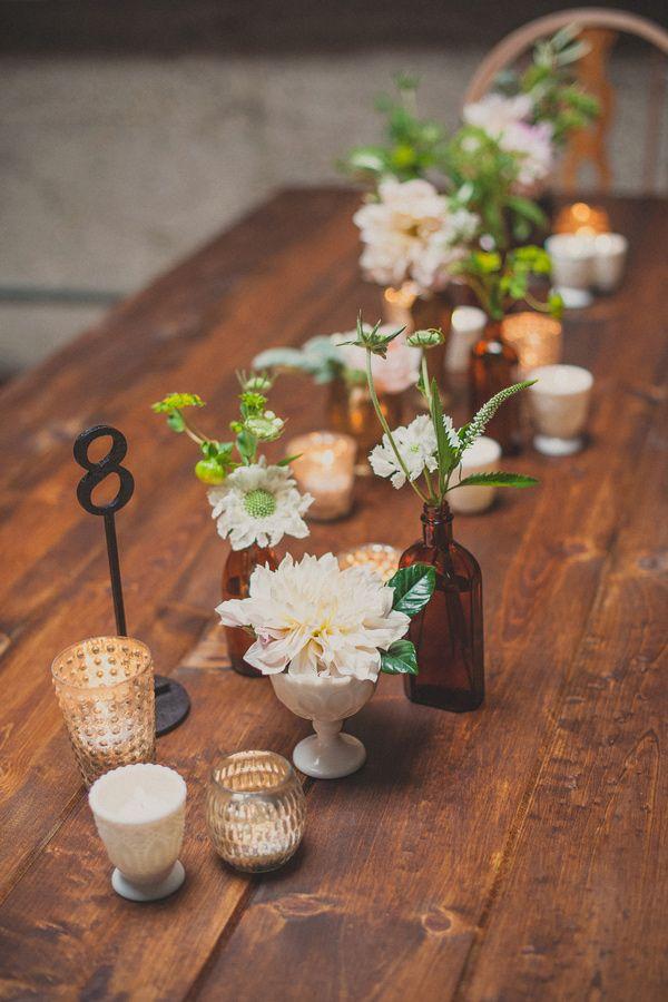 simple + elegant tablescape, photo by Next to Me Studios http://ruffledblog.com/san-diego-loft-wedding #flowers #centerpieces #tablescape