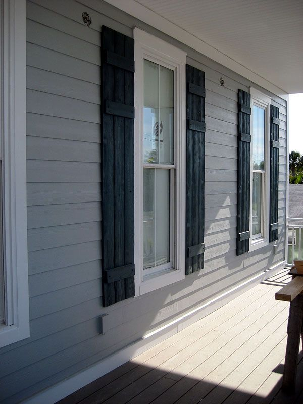 gray house with dark blue shutters and white trim