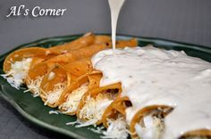Panchos Sour cream enchiladas...for years i been trying to copy the flavor and style of thier enchiladas..recipes for the authentic copy of these enchiladas are innacurate,it calls for green sauce,NO!it does not they are covered in a red sauce with pimentos and sour cream over the top.cheese stuffed on the inside..next time i go i will take a pic of what they are supposed to look like...