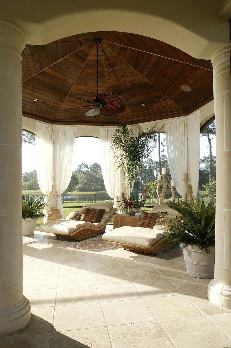 Mediterranean style outdoor cushion rock patio umbrella hot tub patio - A Tropical Tuscan Style Patio With A Beautiful Stained Wood Ceiling And Gorgeous Stone Tile Floor The Decor Is Complete With Two Large Chaise Lounge