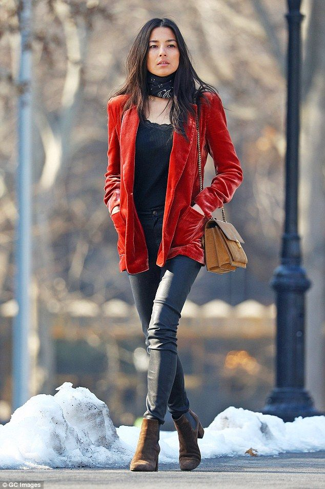Feeling chilly? Jessica Gomes takes a solo stroll in freezing New York conditions wearing a thin camisole and velvet blazer on Wednesday, warming her hands up in her pockets as she chooses to forgo gloves