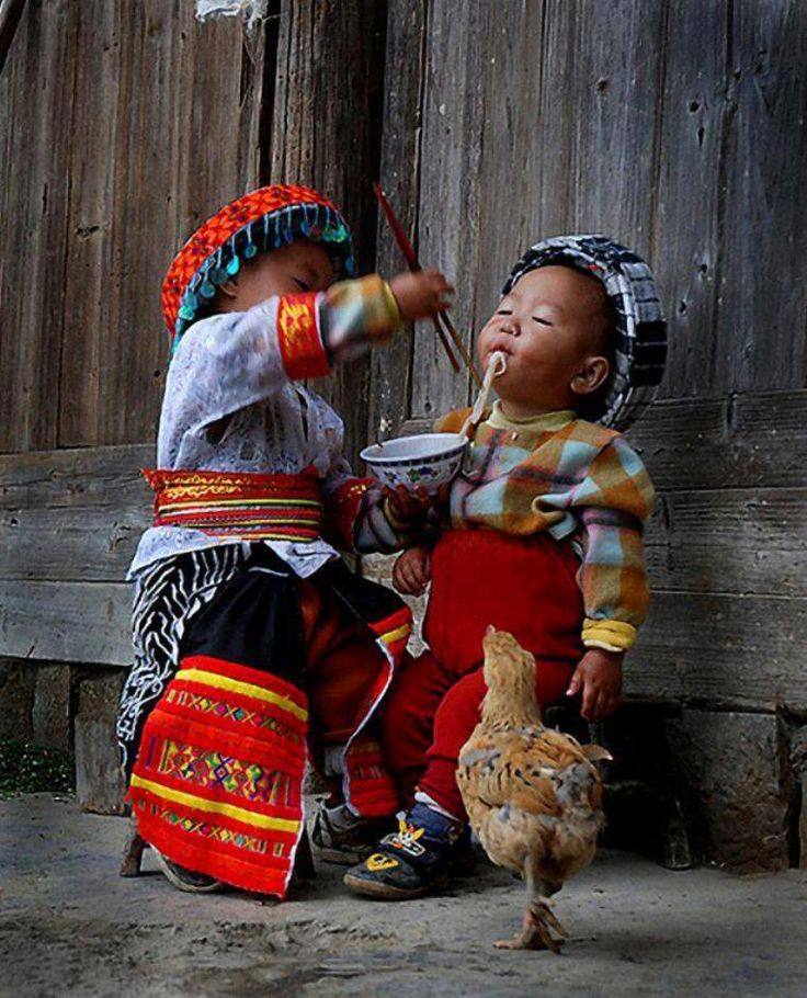 Feeding baby brother in  Mongolia as bird watches.. Similar colors as well.                                                                                                                                                      More