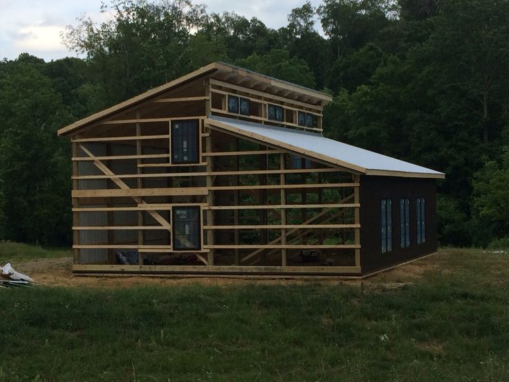 Framing of our pole barn home with clerestory windows across top