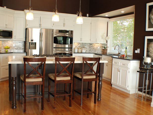 Love the contrast between the island and the white counter tops!