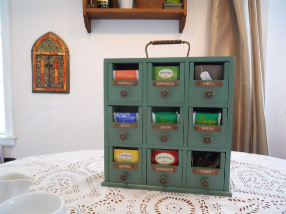 Green wooden tea box with drawers
