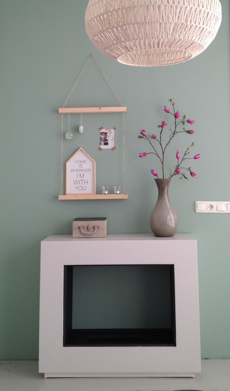 Love the pops of pink against the sage green