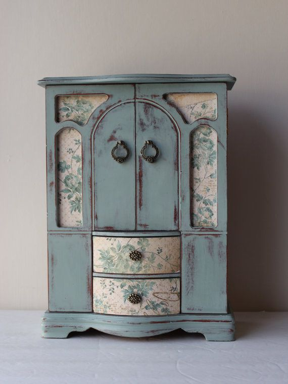 I repainted this vintage jewelry box in duck egg blue, distressed it, then last applied clear wax. And embellished with beautiful paper. It has three drawers and two open cabinets with mirror inside, and definitely will make a nice jewelry display for your home decoration. Measurements:
