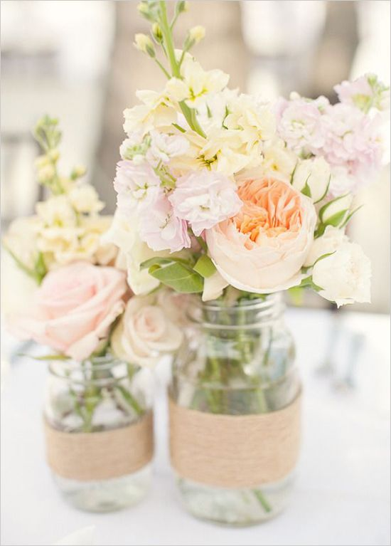 Mason Jar Wedding Ideas: Spruce up some mason jars with lace, twine, ribbon, or cloth and bunch them together and fill them with flowers to create beautiful centerpieces