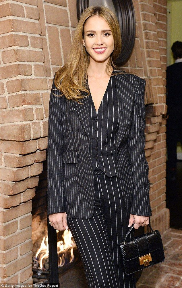 All business: Alba, 35, left her honey blonde locks loose and the vertical stripes of her flares and waistcoat accentuated her slim figure