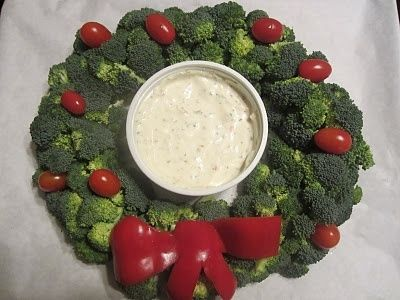 Christmas wreath - broccoli, cherry tomatoes and a red pepper as the bow with ranch dip