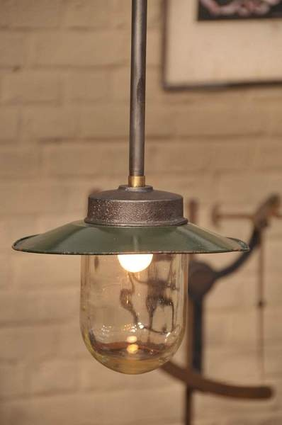 french industrial lighting. detail of french vintage industrial pendant light with old green patina shade lighting