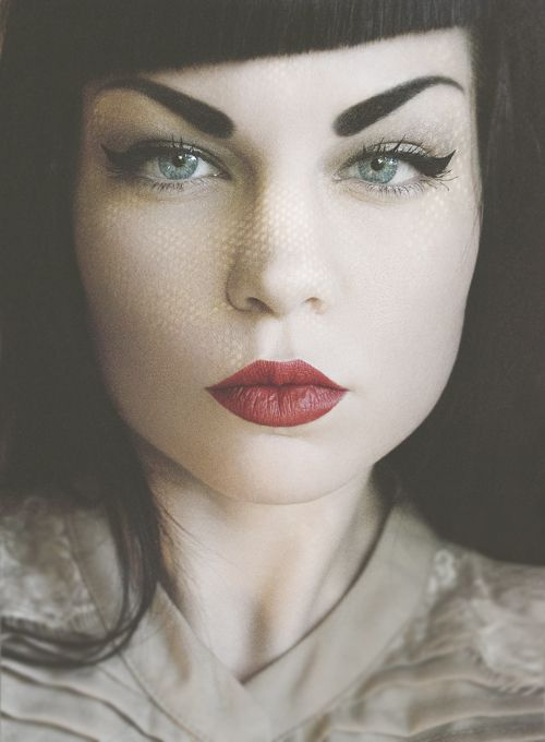 Cateyes & red lips. | http://www.pinterest.com/hilaryswann/portraits-of-people/ I could never pull this off but I love it.