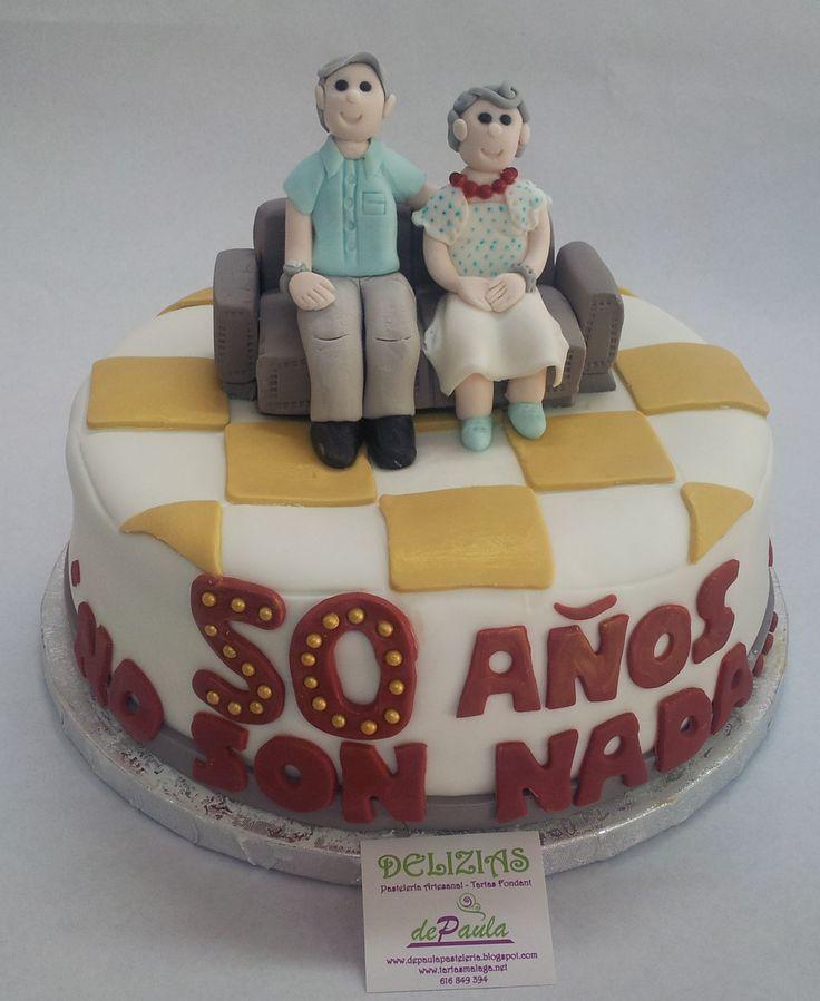 """¡""""50 años no son nada""""!, es la frase elegida por sus hijos. Con la foto de ambos, hemos recreado sus figuras sentadas en el sofá de la casa. ¡Felicidades pareja! ¿Es tu aniversario? ¡Llámanos para encargarnos la tarta decorada en fondant más bonita! ¡Contacta con nosotros al 616849394 y elaboraremos la tarta más rica y vistosa, tenemos el mejor precio de Málaga! www.depaulapasteleria.blogspot.com www.facebook.com/panaderiadeliziasdepaula www.tartasmalaga.net"""