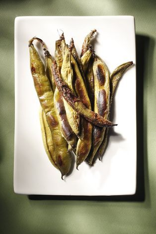 Avoid having to peel them TWICE - roasting them makes the skin and even some of the pods edible.    Roasted fava beans as seen in San Francisco, California, on Wednesday, April 13, 2011. Photo: Craig Lee, Special To The Chronicle / SF