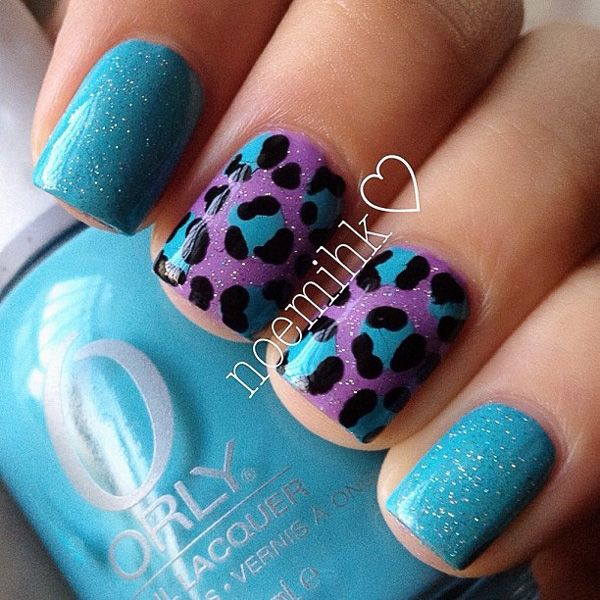 Blue and violet inspired leopard nail art design.