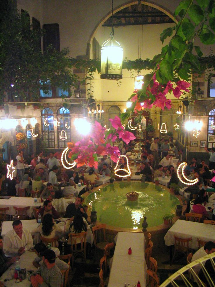 Beit Jabri house now a restaurant in old Damascus. Christmas and Ramadan celebration lights over the grand fountain. This house was rescued by one of the owners sons who restored it back to its glory. The family had rented it out for storage prior to the year 2000  Book: Restoring Damascus  With watered down paint. Amazon