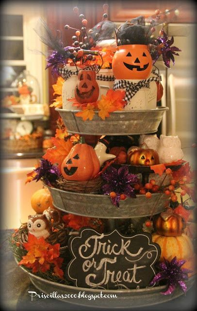 Good Morning! It's time for Halloween decorations in the galvanized tiered tray.. A trick or treat chalkboard is front and center.. Owl salt and pepper shakers from BHG at Walmart..purple sparkly flo