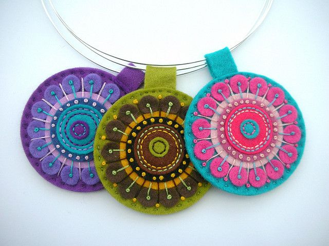 three felt kaleidoscope pendants on silver choker wires by APPLIQUE-designedbyjane . flickr.com
