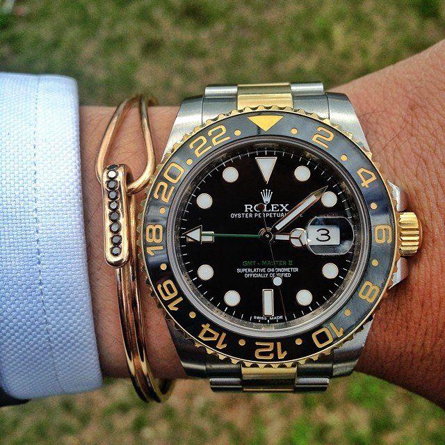 Rolex GMT Master II.   I like the wire bracelet.