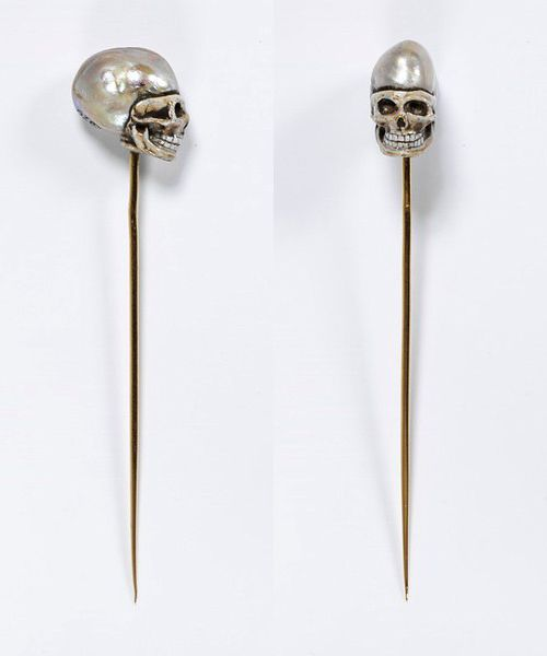Memento mori stick pin with baroque pearl. Made in Europe in the early 19th century.