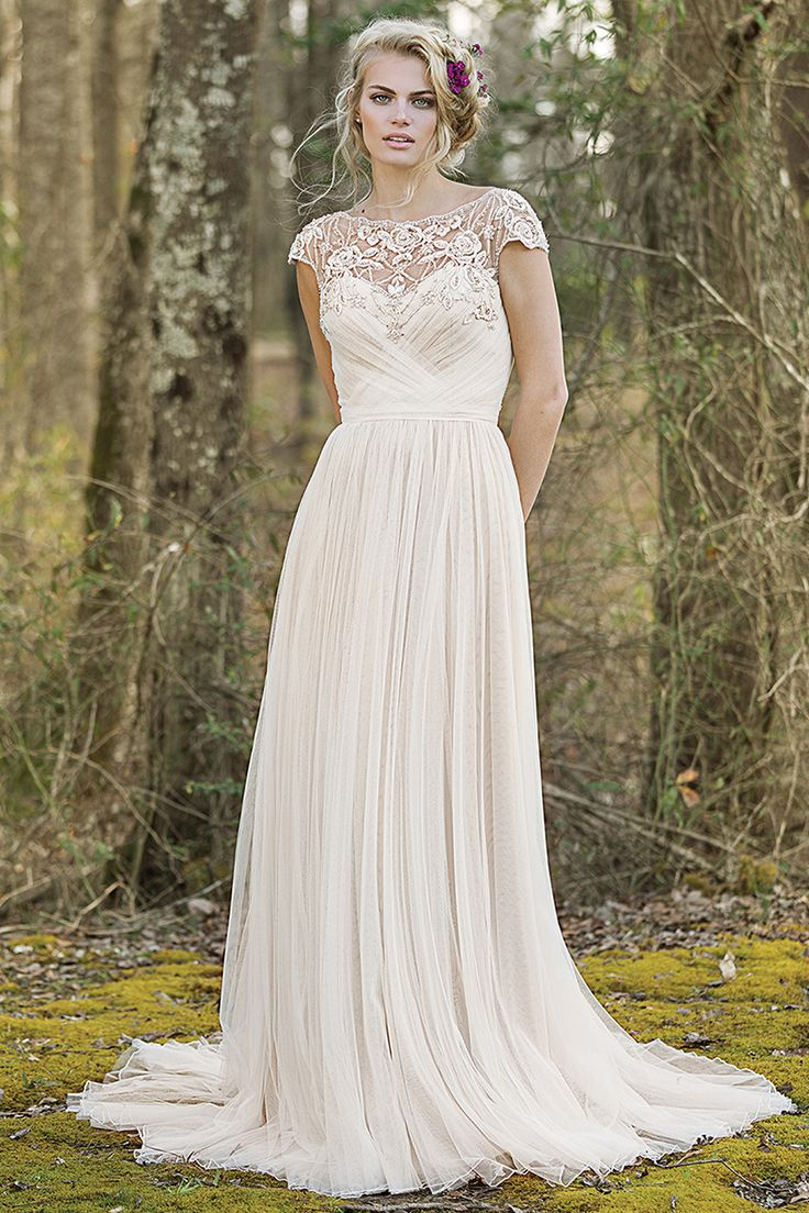 Wedding gown by Lillian West.                                                                                                                                                                                 More