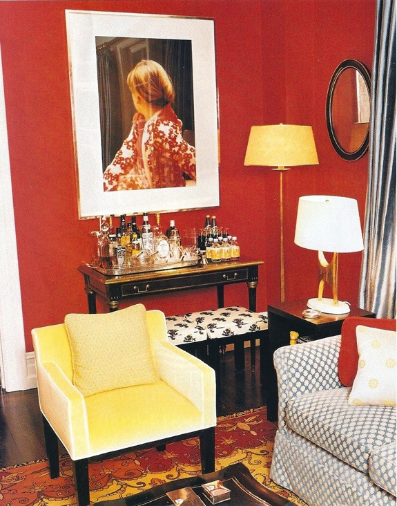 well-organized bar table and the yellow against that lovely red wall....chic!