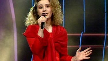 1990 Eurovision UK Entry (No. 6) Give A Little Love Back To The World - Emma. 'Give A Little Love Back To The World', written and composed by Paul Curtis, was the United Kingdom's entry at the Eurovision Song Contest 1990, performed by Emma. At the age of 15, Emma was the youngest-ever entrant on behalf of the United Kingdom at Eurovision. Emma won the right to perform at Zagreb by winning the UK national final... https://en.wikipedia.org/wiki/Give_a_Little_Love_Back_to_the_World
