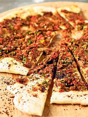 Put the onion and pepper on to fry and after a while add the meat. The Turkish Pizza recipe is too cute