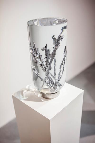 Michal Smandek, Untitled, 2013, sculpture (lead, water, glass, steel, wooden pedestal)