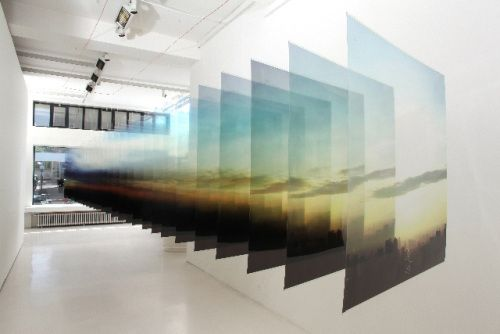 Nobuhiro Nakanishi's Layered Landscapes are pieces of pure beauty. The pieces consist of hanging sheets of acetate with still images affixed to them. Like a slide show or a film strip slowed down, expanded and hung to dry, they attempt to pause the movement of clouds and air over cities and mountains while giving a sense of the momentary fleetness each blink of an eye can contain. Powerful statements in a beautiful, simple execution.