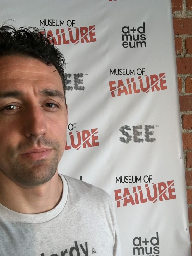 Me in front of the Museum of Failure promo board,  annoyed by the people running place.