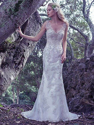 Maggie Sottero - GREER, This bead embellished sheath wedding dress features Swarovski crystals. The illusion straps and plunging V-neckline add statement-making glamour. Finished with stunning scoop open back and zipper closure.