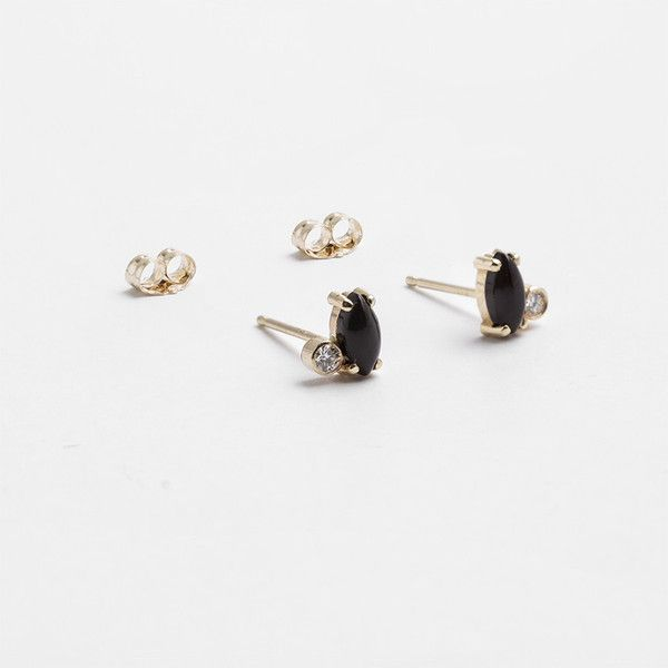 "MATERIALS14k gold, onyx marquis, white diamonds DIMENSIONSonyx marquis is 2/8"" long ADDITIONAL DETAILSThese studs are set with onyx marquis cabochons and white"