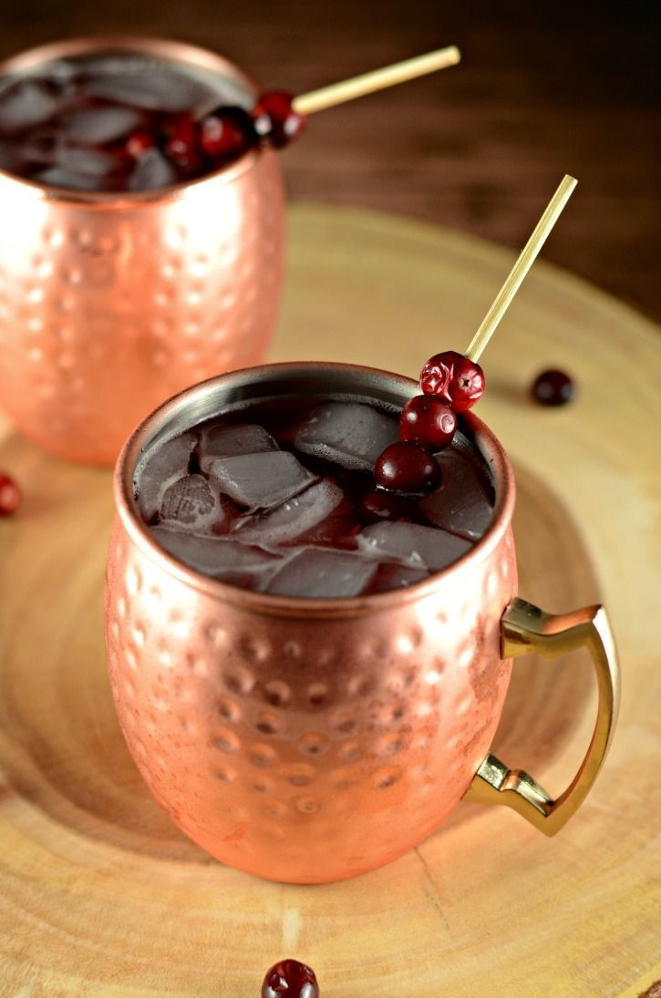 Enjoy a delicious Cranberry Apple Moscow Mule drink recipe featuring Smirnoff Sourced vodka. A perfect drink to enjoy these colder months.