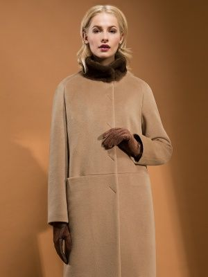 """Трендовое зимнее пальто прямого силуэта из ворсовой ткани с декоративным горизонтальным подрезом, в котором расположены карманы. Модель имеет длинный рукав, застежку на потайные пуговицы и втачной воротник стойку из натуральной скандинавской норки изысканного оттенка темного ореха. Воротник застегивается на шубный крючок. В этой модели использован инновационный утеплитель Raft Pro Thermo, созданный с использованием запатентованного биополимера от """"DuPont Sorona"""", обладающий превосходными ..."""