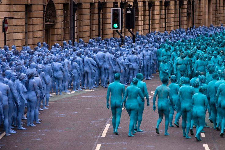 Naked volunteers, painted in blue to reflect the colours found in Marine paintings in Hull's Ferens Art Gallery, prepare to participate in US artist, Spencer Tunick's 'Sea of Hull' installation on the Scale Lane swing bridge in Kingston upon Hull on July 9, 2016. Over a period of 20 years, the New York based artist has created over 90 art installations in some of the most culturally significant places and landmarks around the world including the Sydney Opera House, Place des Arts in…