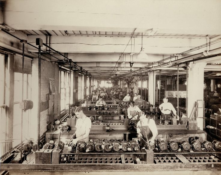 Workers in the power motor assembling department of Emerson Electric Manufacturing Company. 2012-2032 Washington Avenue. ca. 1920s