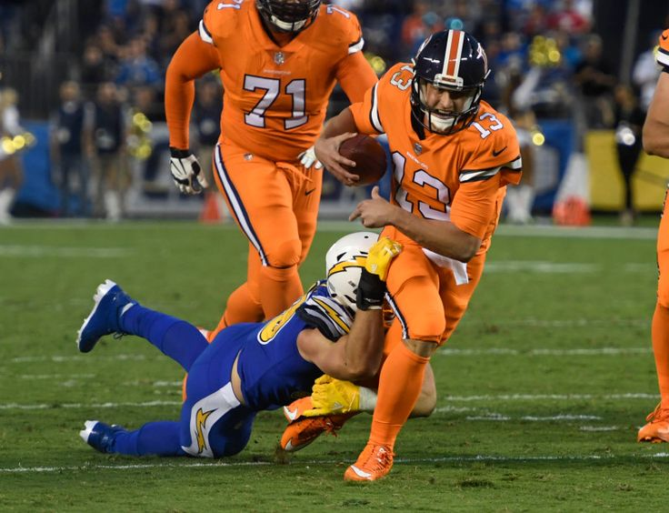 Broncos vs. Chargers:   October 13, 2016  -  21-13, Chargers   -       Denver Broncos quarterback Trevor Siemian (13) gets caught from behind by San Diego Chargers defensive end Joey Bosa (99) during the second quarter Oct. 13, 2016 at Qualcomm Stadium in San Diego, Calif.