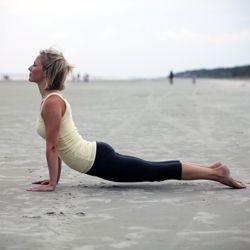 A Month of Yoga: The Cobra Pose - Dr. Weil's Weekend Tip - oga can invigorate your immune system, release stress and enrich your life overall. The Cobra Pose is especially powerful: It is said to promote flexibility in the spine and encourage the chest to open