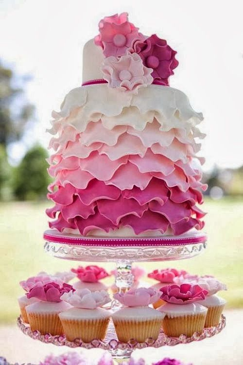 Ruffled pink wedding cake with cute cupcakes #wedding #weddingcupcakes #cupcake #cake #pink