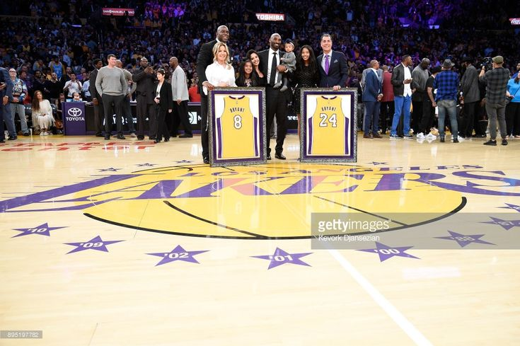 Kobe Bryant poses with his family and Earvin Johnson, Rob Pelinka and Jeanie Buss at halftime after both his #8 and #24 Los Angeles Lakers jerseys are retired at Staples Center on December 18, 2017 in Los Angeles, California.