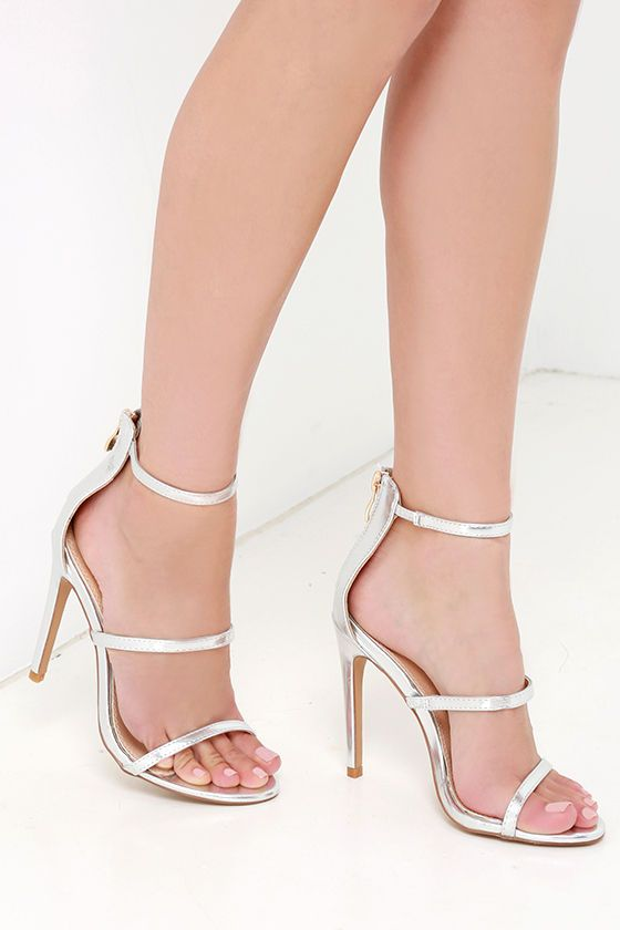 """You'll be all dolled up in two shakes with the Three Love Silver Dress Sandals! A minimal, metallic silver vegan leather upper has three skinny straps, a peep toe, and a 3.25"""" heel zipper with shiny gold pull."""